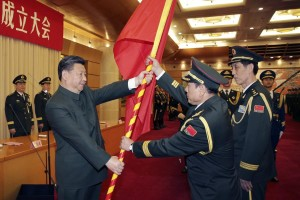 (160101) -- BEIJING, Jan. 1, 2016 (Xinhua) -- Chinese President Xi Jinping (L F) confers the military flag to Wei Fenghe (C F), commander of the Rocket Force of the Chinese People's Liberation Army (PLA), and Wang Jiasheng (R F), political commissar of the Rocket Force, in Beijing, capital of China, Dec. 31, 2015. The general commands of the PLA Army, Rocket Force and Strategic Support Force were founded on Thursday. (Xinhua/Li Gang) (zwx)