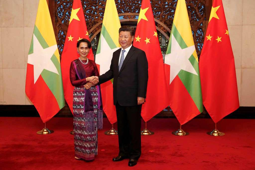 Myanmar State Counsellor Aung San Suu Kyi (L) and Chinese Premier Xi Jinping (R) poses for the media before a meeting at the Diaoyutai State Guesthouse in Beijing, China, on 19 August 2016.