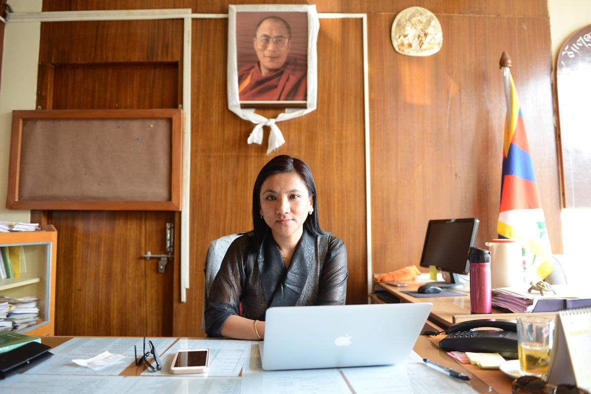 Dhardon Sharling poses for a photo at her desk on the second day of her appointment as the Information Secretary of the Department of Information and International Relations of the Central Tibetan Administration, in Dharamshala, India, on 5 October 2016.